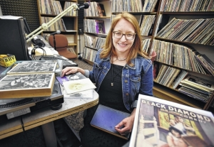 King's College Professor Noreen O'Connor displays some of her research materials on local film history in the college radio studio, where she broadcasts a weekly radio show.  Aimee Dilger | Times Leader